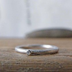 Rhodium plated silver ring with a diamond