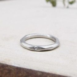 White gold facet wedding ring and diamond