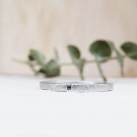 Hammered silver wedding band with black diamond