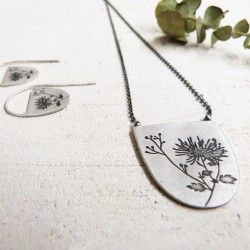 Flower engraving on silver necklace