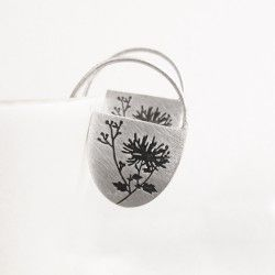 Silver earrings with floral engraving