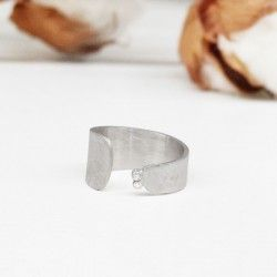 Wide rhodium silver ring with diamonds