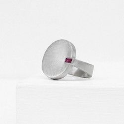 Silver ring with a ruby